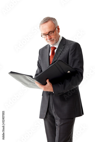 Mature business man with folder, reading