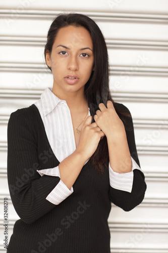 Attractive Hispanic female touching her hair