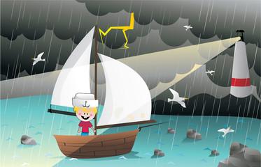 niño navegando en un velero