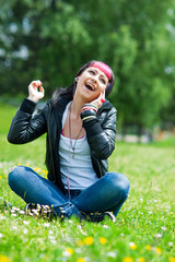 teen girl listen music in the grass