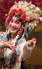Pretty chinese opera actress performs on stage