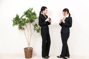 two asian businesswomen relaxing