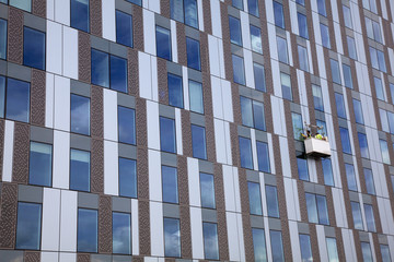 Window Cleaners Working on a Tall Building