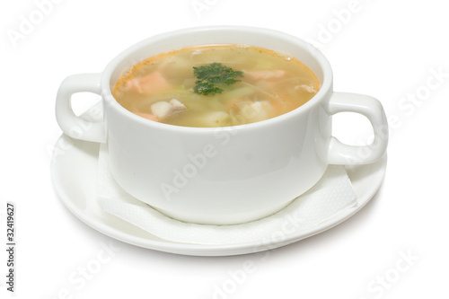 Soup with seafood isolated on white
