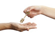 Female hand handing key over to another woman