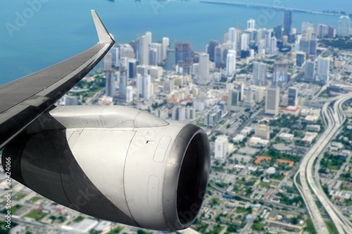 airplane wing aircraft turbine flying on Miami