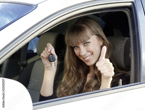 Beautiful young happy woman with car keys