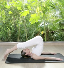 black mat yoga woman window rainforest jungle view