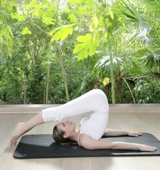 black mat yoga woman window rainforest jungle view