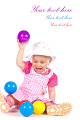 Baby girl playing with balls