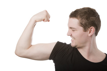 Young man looking at his biceps on isolated on white