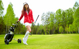 female golf player walking on fairway with their golf trolleys poster