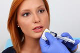 Attractive young woman receiving botox injection
