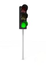 Green traffic light over white background