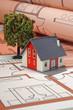 Haus auf Bauplan