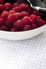 Fresh raspberries in black bowl