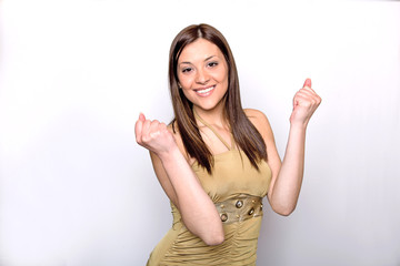 Portrait of attractive young female showing thumbs up