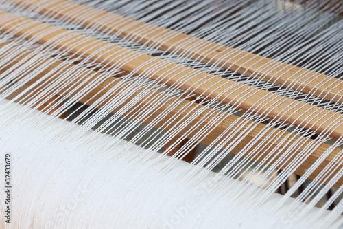 Leinwanddruck Bild background of the loom at the fair