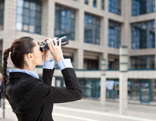 businesswoman looks into the future