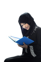 Beautiful muslim women check her notebook