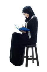 Beautiful muslim women sit and read