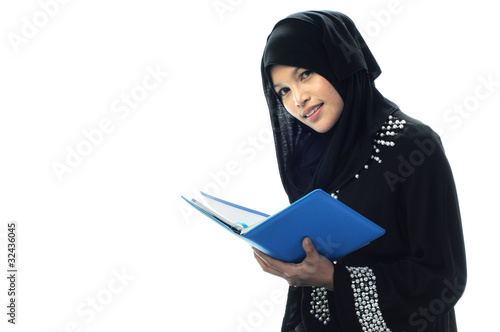 Beautiful muslim women hold her notebook and smile
