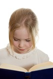 Little girl with open book solated on white background