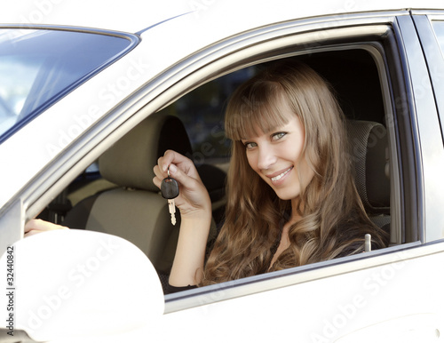 Pretty girl holding car key