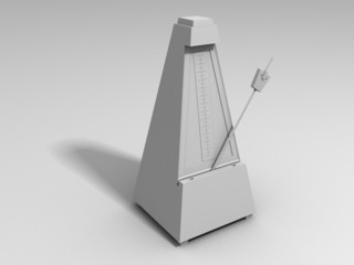 white metronome on a white surface