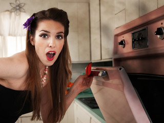 Surprised Housewife Checks the Oven