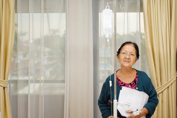 ethnic elderly woman patient in hospital ward