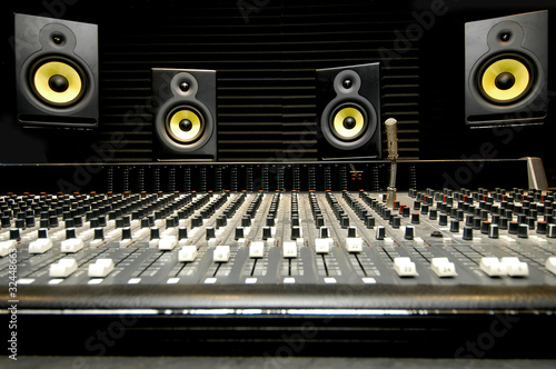 Leinwanddruck Bild Mixing desk with speakers