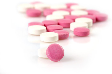 closeup of white and pink pills