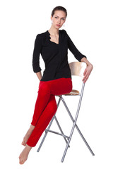Young confident business woman sitting on the stool