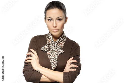 Young business female standing with crossed arms