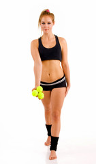 Young attractive Caucasian fitness woman with 3 tennis balls