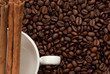 White coffee cup background over beans and canela