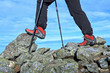 Hiking woman legs in mountains