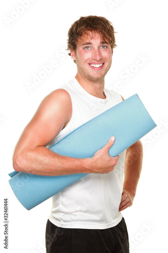 Fitness man holding yoga mat isolated