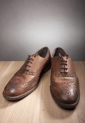 Classical shoes on wood