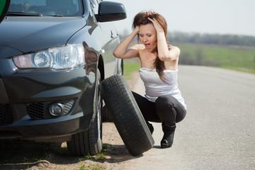 woman during  wheel changing