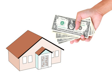 Hands with money and miniature house on a white background