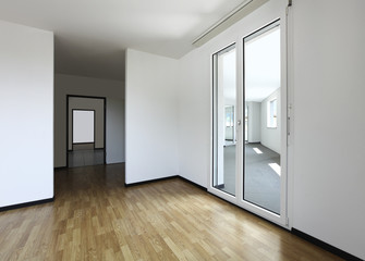 new apartment, empty room with hardwood floor