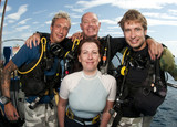 group of friends on boat before scuba dive poster