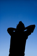 silhouette of man relaxing