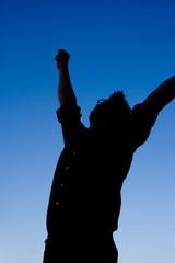 silhouette of man celebrating