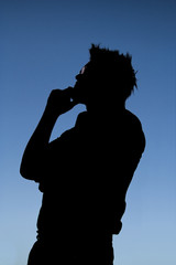 silhouette of man thinking
