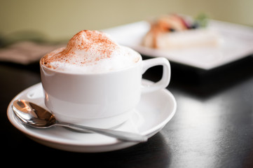 A cappuccino cup with milk foam and cinnamon