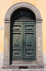 Green door in Lucca, Italy