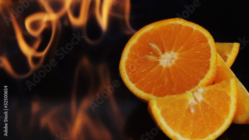 Orange fruit in fire flame